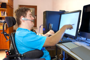 a man pointing the computer monitor